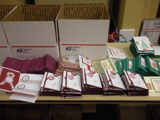 "handcrafted cards waiting to be ""stuffed"" at annual Christmas in August event for From Our Hearts"