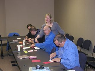 Melissa Flys Into Action To Assist A Rorke Employee Making Greeting Cards For The Troops 110910
